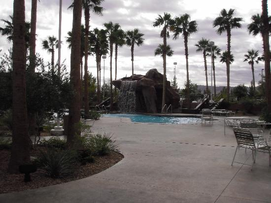 Grandview at Las Vegas: Pool area with waterfall on a cloudy day