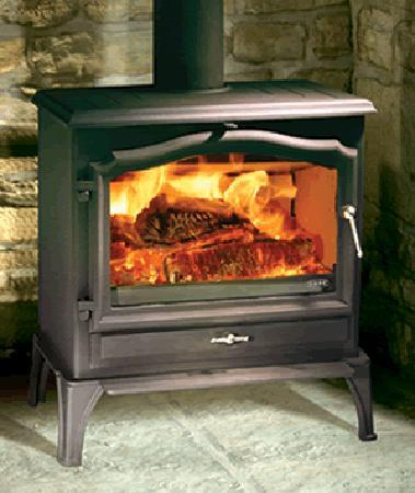 Chillers Bar & Grill: relax in front of the woodburning stove at ice factor bothan bar