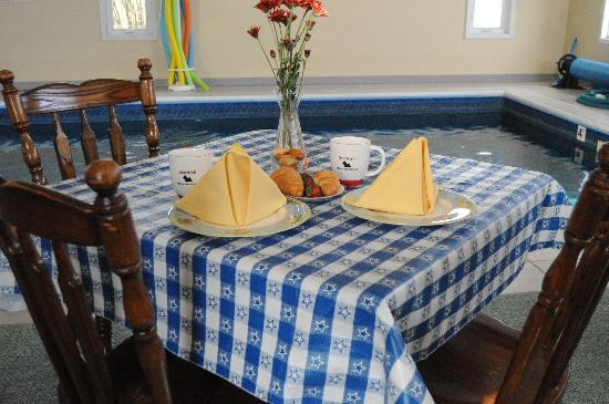 Bremen, IN: INDOOR POOL ROOM - where guests can eat their breakfast