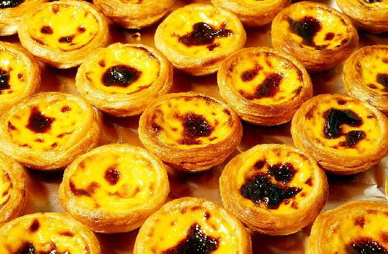Savor the delicate custard of Macau's famous Portuguese Egg Tarts.