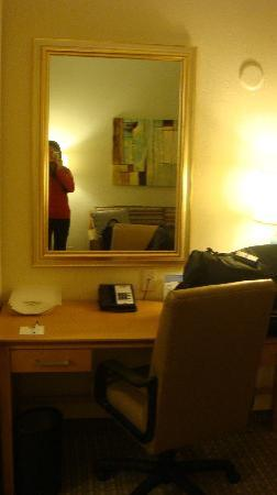 Holiday Inn Express Hotel & Suites: Desk, one of the mirrors & sofa (sitting area)