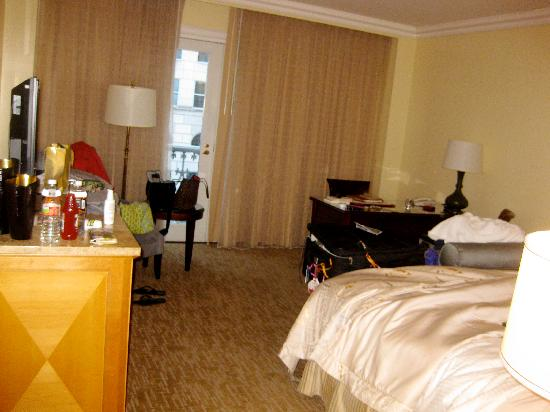 Hotel Crescent Court: view standing next to bathroom, into the room (tv on dresser, doors to 'balcony' and desk