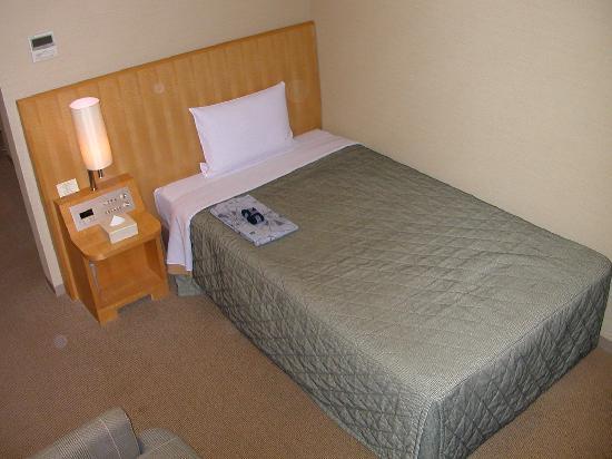 Hotel Brillante Musashino: ベッド