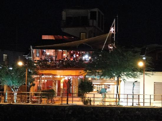 Hotel Miconia at night, seen from the pier in front.