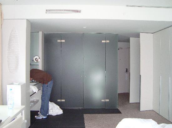 W Barcelona: Odd Bathroom/Bedroom Set Up (Husband Brushing Teeth In Sink)