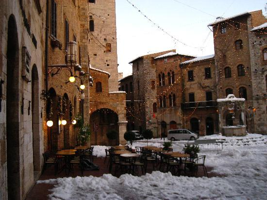 One of the restaurants in the Piazza della Cisterna, San Gimignano, Tuscany, Italy.