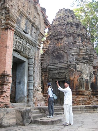 David Angkor Guide - Private Tours: Explaining the carvings to us at Preah Ko