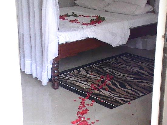 Rose petals in bed at Tumaini cottage Arusha