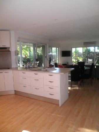 Noosa Riviera: The kitchen to the hall and the garden