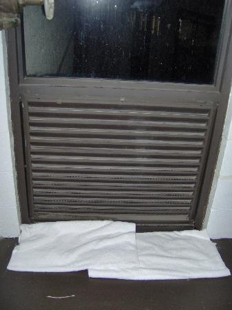 Holiday Inn Express in Wilkesboro : Towels used to block the rain water at the stair well