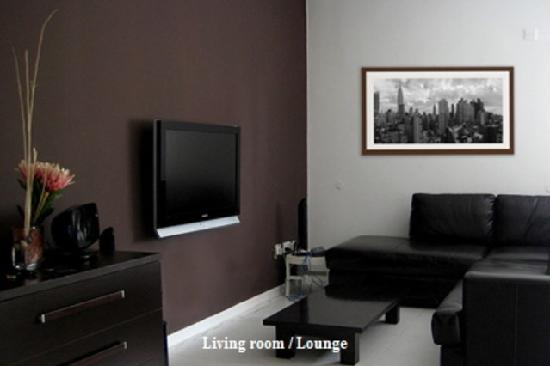 Room 4 You: The TV lounge really sets the standard for the rest of this modern accommodation.