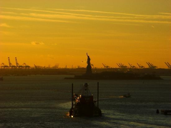 Brooklyn Bridge: Statue of Liberty from the bridge at sunset