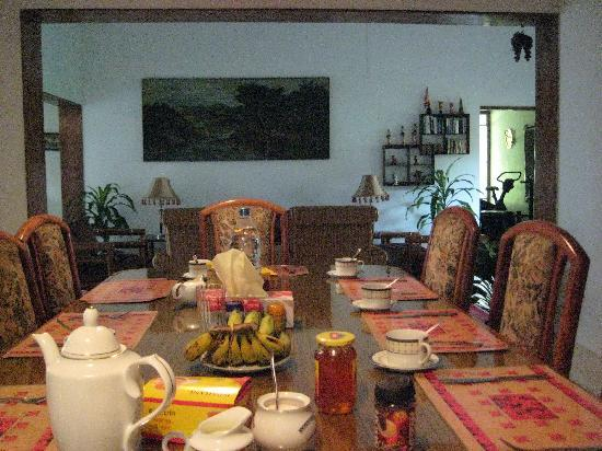 Ambrosia : main eating area, at breakfast - lots of tea; instant coffee