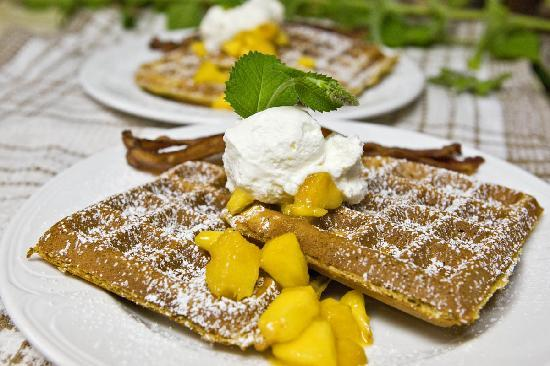 Cedar Springs Bed and Breakfast Lodge: 12-grain Belgian Waffles with fresh peach compote and whipped cream served with Alder-smoked bac