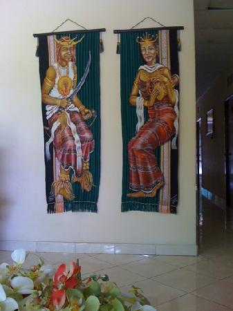 Oriental Hotel: People wearing tebe-tebe wall ornament
