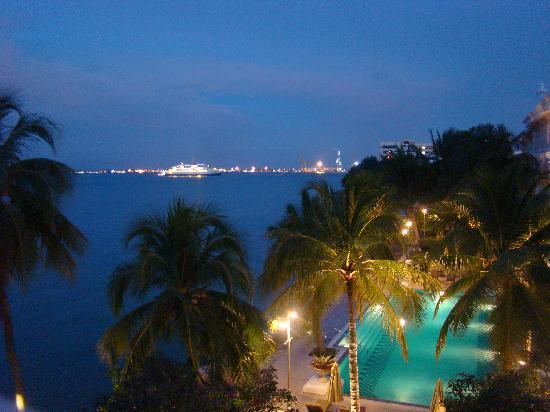 Eastern & Oriental Hotel: View of the pool and the straits of Malacca.