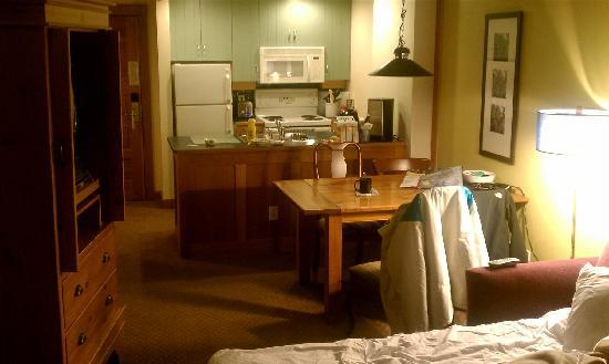 Legends: View inside the family room of our room looking at the fully equipped kitchen.