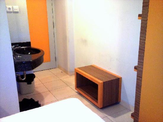 Studio One Residence: The shoe rack behind the room door.