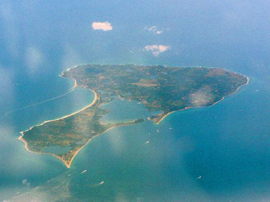 Block Island Ferry: Block Island from a plane - New Harbor on right, Crescent Beach on left