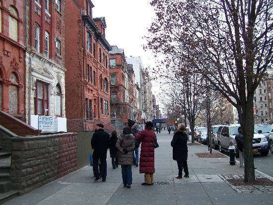 Welcome to Harlem: Viewing brownstones on Malcolm X Blvd.