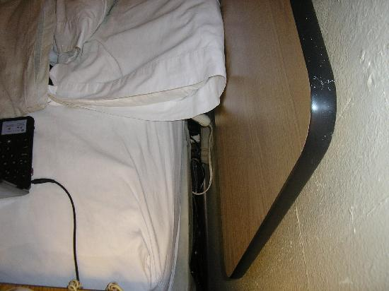 Motel 6 El Paso-Airport-Fort Bliss: Matress pulled away from wall to access electrical outlet.