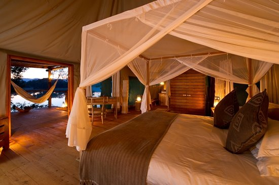 Chindeni Bushcamp - The Bushcamp Company: The view from bed in your tent onto the lagoon at Chindeni Bushcamp, Luangwa, Zambia