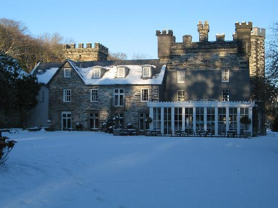 The dining room side to Castell Deudraeth in the snow