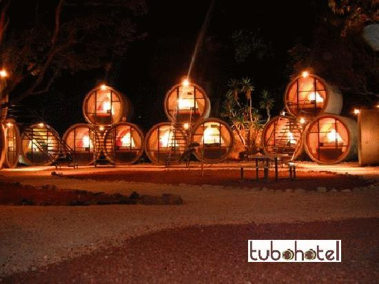 Tubohotel: the tube pyramids illuminated at night make for a cool place to gather and meet new friends