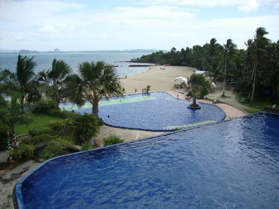 Lucena City, Philippines: View of the pool and beach from the hotel terrace