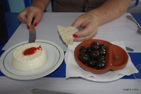 Rabo de Peixe, Portugal: Goat's milk fresh cheese with Massa de Pimenta (pepper sauce) black olives and fresh bread