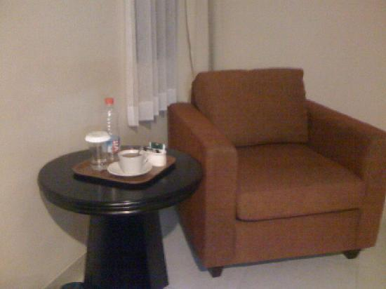 Prasada Mansion: The armchair on the corner of the room, with complimentary drinks in the room