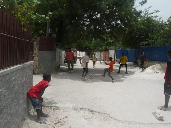 St. Joseph's Home for Boys : Enjoying the world's most popular game near the entrance