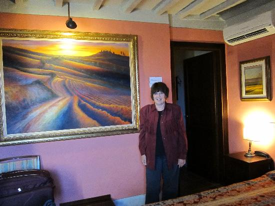 Locanda Viani: The Red Room with Roberto's art