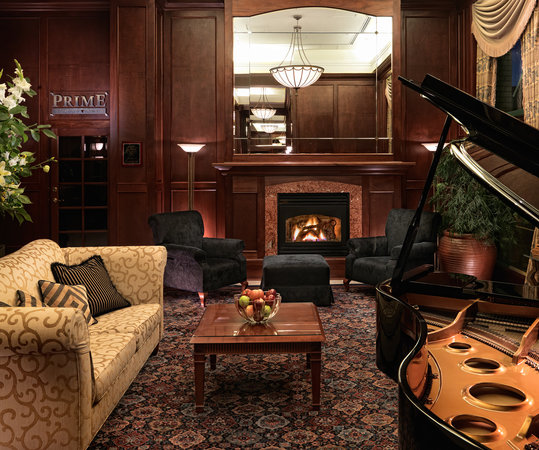 Magnolia Hotel And Spa : Curl up by the fire and enjoy coffee, tea and music from our baby grand