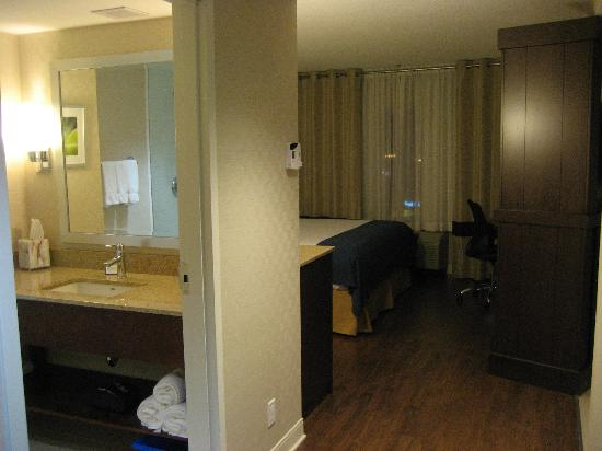 "Holiday Inn Express Toronto - Markham: In the hall between ""living room"" and bedrrom. Bathrrom on the left.  Jaccuzzi around corner on"