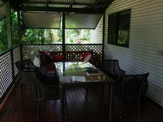 Cocos Beach Bungalows : The verandah with the daybed/sofa to the rear