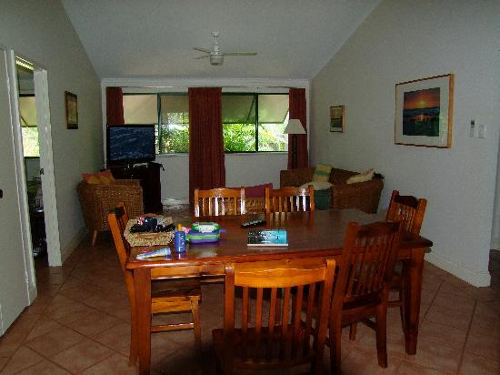 Cocos Beach Bungalows: The dining and family area from the front door; master bedroom door visibkle to the left