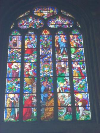 The colors splashing to the floor from the original stained glass windows are splendid