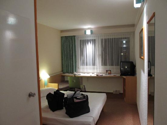 Ibis Hotel Airport Tegel: View of room from doorway off hall; bathroom is door to left.