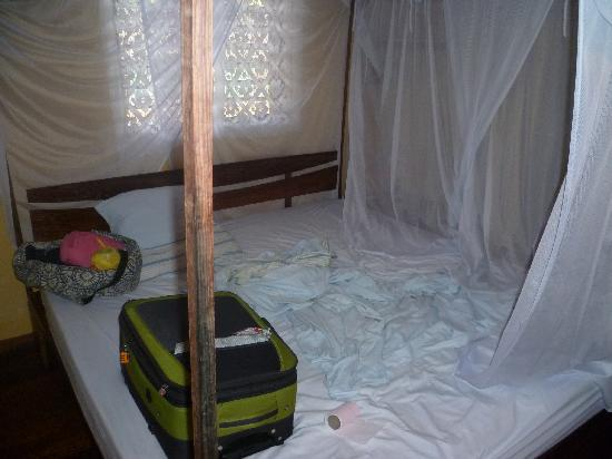 Chez Eugenie: The massive double bed with mosquito net