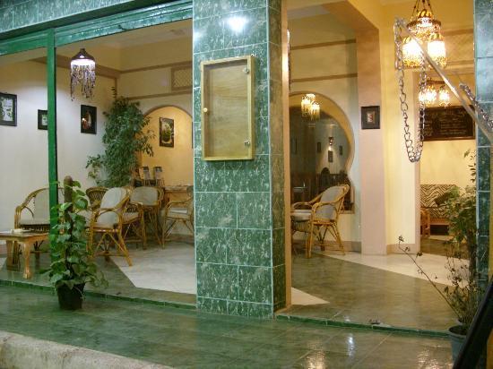 Secret Garden Cafe: Secret Garden Entrance and Smoking Area
