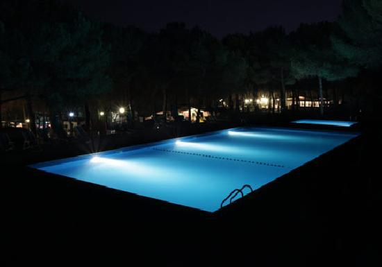 Swimming pool by night picture of camping centro turistico belvedere civitanova marche for A swimming pool is 50m long and 20m wide
