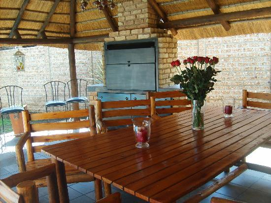 Outdoor dining area picture of rustic rose guest house for Rustic dining area