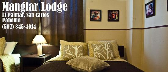 manglar lodge, one of our beds with original photos on the back