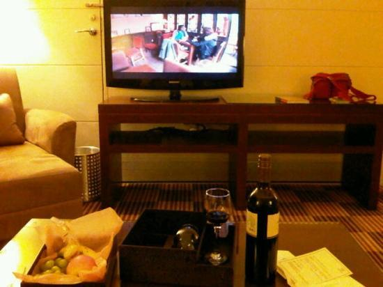 Sheraton Hong Kong Hotel & Towers: living room and compliment @ harbor view suite1002