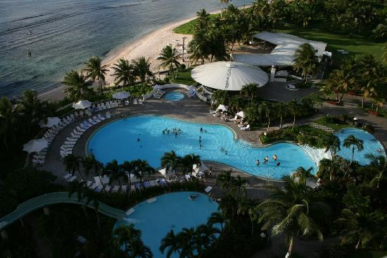 Hotel Nikko Guam: The pool and beach seen from the balcony.