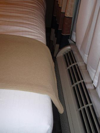 Holiday Inn Express Hotel & Suites Houston NW-Beltway 8-West Road: bed next to heating & A/C unit