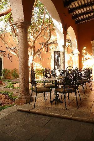 Courtyard/patio bar w/ adjoining restaurant