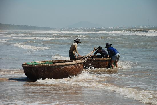 Golden Coast Resort and Spa: Local Fishermen (Phan Thiet on horizon in background)