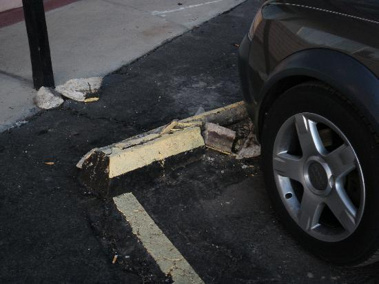 Friendship Inn Salina : Parking stops all in pieces all over the lot
